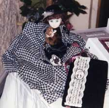 Nellie Bly doll with book